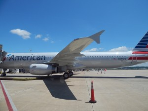 A US Airways A321 in the new livery sits at DCA (by Ryan Ewing)
