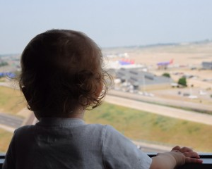 JL's young son, also named JL, watches out the window as planes operate down on the ramp at the Renaissance Hotel across from Lambert St. Louis International Airport. | Photo provided by JL Johnson
