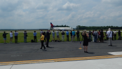 Aviation enthusiasts, along with journalists from the D.C. area wait for an inaugural flight from Asia to touch down at Dulles International Airport this past summer. | Photo provided by Ryan Ewing