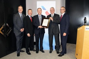 American Airlines Group Executives Hold the Newly Received SOC (Photo via American Airlines)