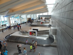 A view from the upper deck's lounge looking over the three baggage claim carousel