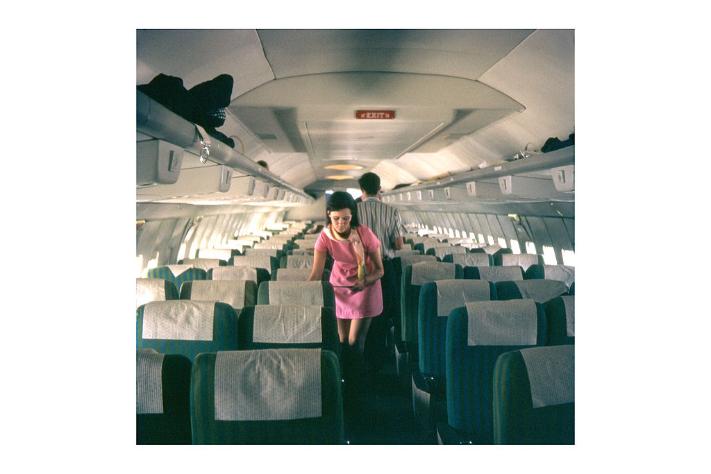 Photo of a Braniff flight attendant in her colorful outfit. Photo courtesy of By clipperarctic (Stewardess 707 Uploaded by russavia) [CC BY-SA 2.0 (http://creativecommons.org/licenses/by-sa/2.0)], via Wikimedia Commons
