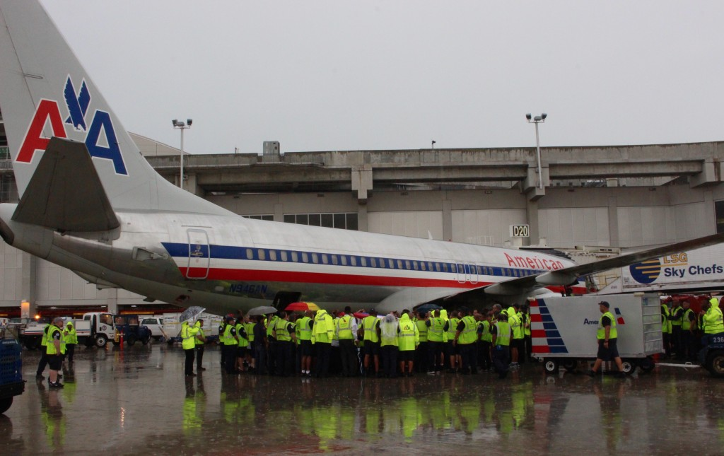 Some American employees gather around a 737 to say their final goodbyes to a beloved employee