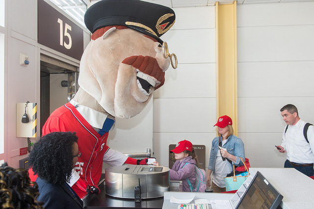One of the Nationals mascots scanning passengers' boarding passes at DCA (Photo provided by Delta)