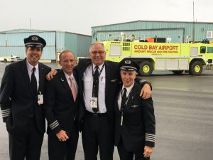 American Airlines crew poses in front of Cold Bay Airport fire and rescue vehicle (Photo: American Airlines)