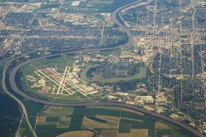 City of Omaha and Epply Airfield, with the Missouri River forming the border between Iowa (on the left) and Nebraska (on the right). Council Bluffs, IA on the upper left corner. Taken from an altitude of 36,000 feet, looking south.