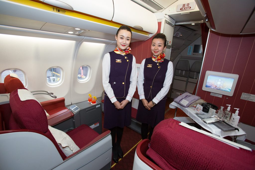 Flight attendants at Hainan Airlines ensure that the five-star rating of quality is ensured - Picture from Manchester Airport.
