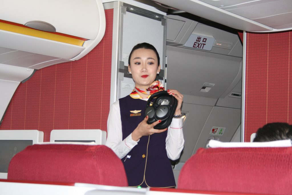 Flight Attendants were advertising the use of Bose Headphones that can be used by Business Class members.